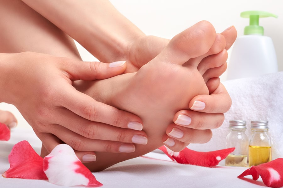 get rid of cracked heels by covering your feet in essential oils